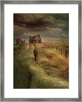Old Man Walking Up A Path Of Tall Grass With Abandoned House In  Framed Print by Sandra Cunningham