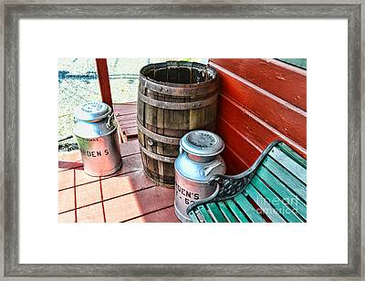 Old Milk Cans And Rain Barrel. Framed Print by Paul Ward