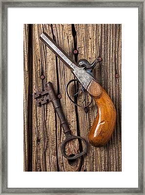 Old Pistol And Skeleton Key Framed Print by Garry Gay