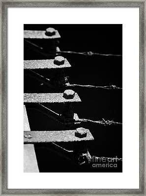Old Rusty Rusted End Posts Tensioners Of A Barbed Wire Security Fence Framed Print by Joe Fox