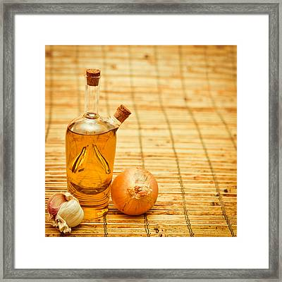 Olive Oil Framed Print by Tom Gowanlock