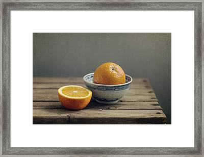 Orange In Chinese Bowl And Half Orange On Table Framed Print by Copyright Anna Nemoy(Xaomena)