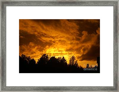 Orange Stormy Skies Framed Print by Randy Harris