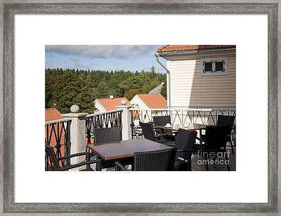 Outdoor Seating On A Patio Framed Print by Jaak Nilson