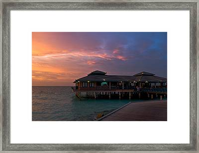 Overwater Restaurant. Maldives Framed Print by Jenny Rainbow