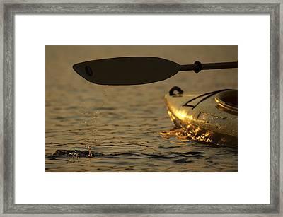 Paddling A Kayak Over Walden Pond Framed Print by Tim Laman
