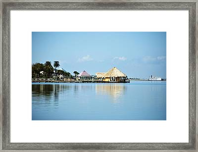 Palapa Over The Bayou Framed Print by John Collins