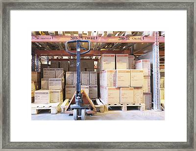 Pallet Jack And Boxes Framed Print by Magomed Magomedagaev
