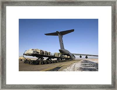 Pallets Await Loading Onto A C-5 Galaxy Framed Print by Stocktrek Images