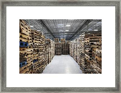 Pallets In A Factory Warehouse Framed Print by Jetta Productions, Inc