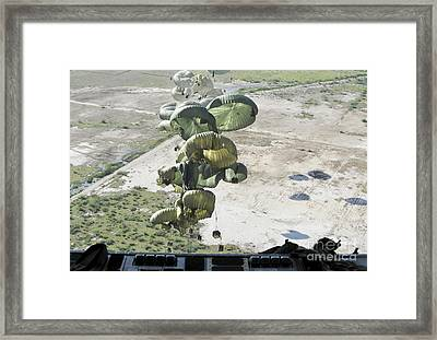 Pallets Of Relief Supplies Are Air Framed Print by Stocktrek Images