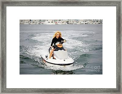 Pamela Anderson Is A Jet Ski Vixen Framed Print by Nina Prommer