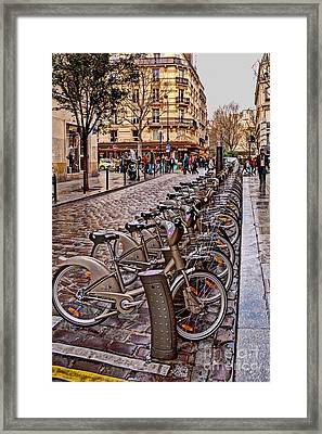 Paris Wheels For Rent Framed Print by Bob and Nancy Kendrick