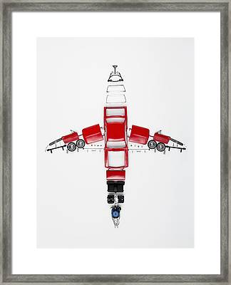 Parts Of A Model Car Arranged In The Form Of An Airplane Framed Print by Larry Washburn