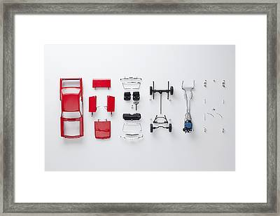 Parts Of A Model Car Framed Print by Larry Washburn