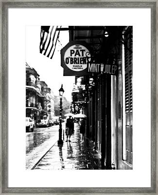 Pat Obriens Rainy Afternoon Framed Print by Roy Guste