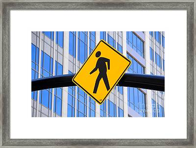 Pedestrian Crosswalk Sign In Business District Framed Print by Gary Whitton