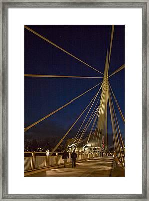 Pedestrians Cross The Modern Bridge Framed Print by Taylor S. Kennedy