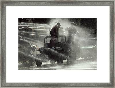 People Are Sprayed At The Water Framed Print by James L. Stanfield