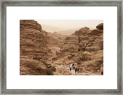 People Walk Along A Path Framed Print by Taylor S. Kennedy