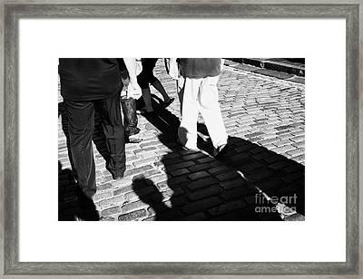 People Walking Along The Cobbled Streets Of Castle Hill Edinburgh Scotland Uk United Kingdom Framed Print by Joe Fox