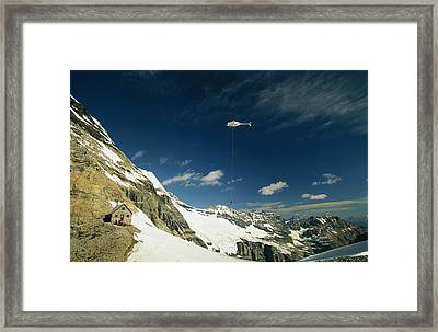 Person Dangles From A Helicopter Framed Print by Michael Melford