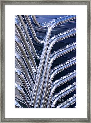 Pile Of Chairs Framed Print by Carlos Caetano