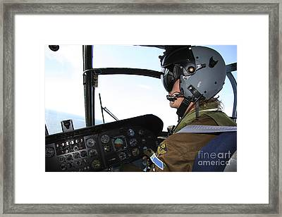 Pilot In The Cockpit Of A Ch-46 Sea Framed Print by Daniel Karlsson