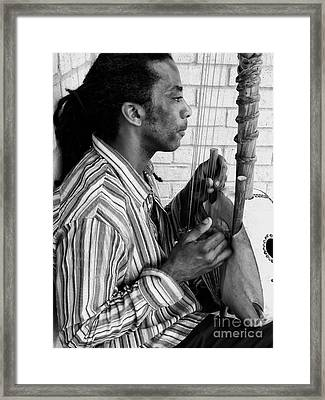 Playing The Koro - Black And White Framed Print by Kathleen K Parker