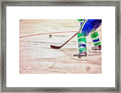 Playing The Puck Framed Print by Karol Livote