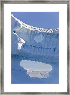 Portion Of A Gigantic Iceberg Framed Print by Ron Watts