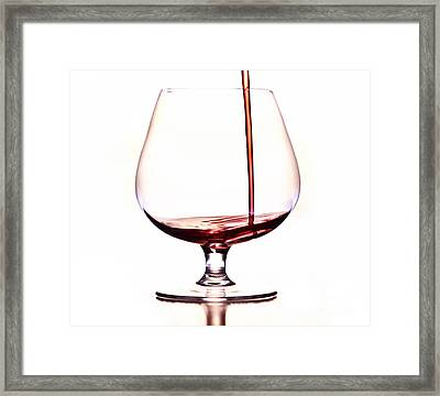 Pouring Wine Framed Print by Michal Boubin