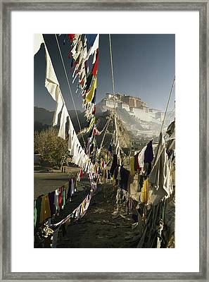 Prayer Flags Hang In The Breeze Framed Print by Gordon Wiltsie