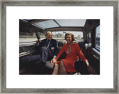 President And Betty Ford Hold Hands Framed Print by Everett