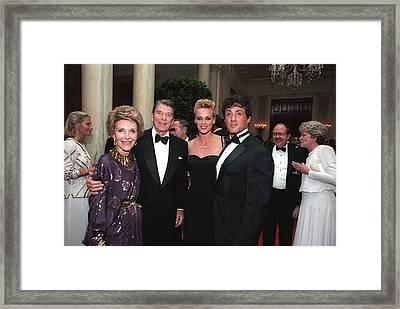 President And Nancy Reagan Posing Framed Print by Everett