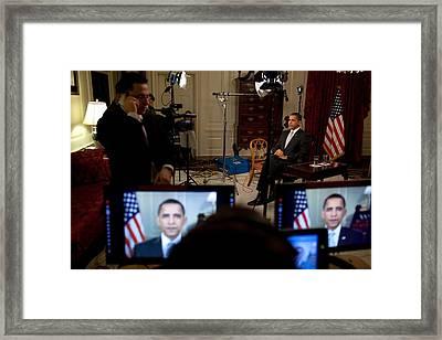 President Barack Obama Conducting Framed Print by Everett
