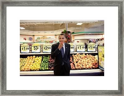 President Barack Obama Eats A Peach Framed Print by Everett