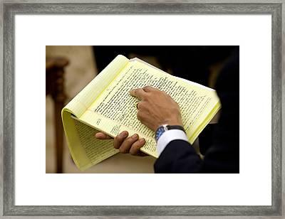 President Barack Obama Holds Framed Print by Everett