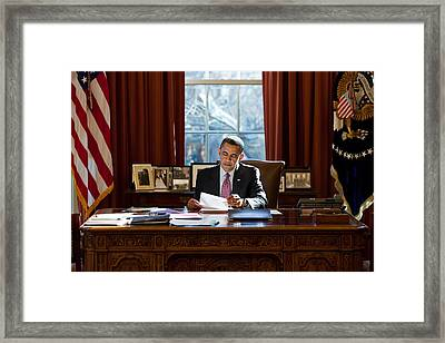 President Barack Obama Reviews Framed Print by Everett