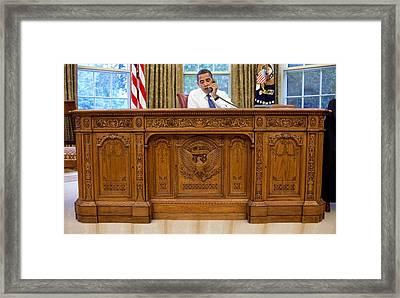 President Barack Obama Sits Framed Print by Everett