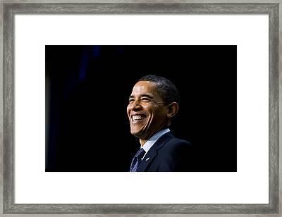 President Barack Obama Smiles While Framed Print by Everett