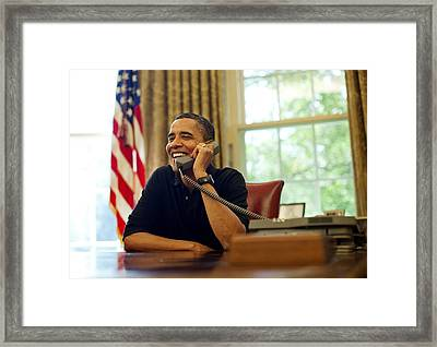 President Barack Obama Talks By Phone Framed Print by Everett