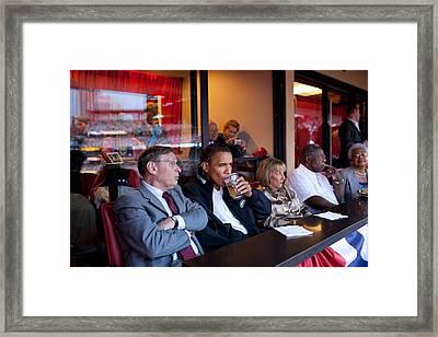 President Barack Obama Watches The 2009 Framed Print by Everett