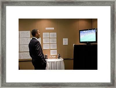 President Barack Obama Watches The U.s Framed Print by Everett