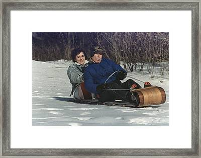 President George Bush Goes Sledding Framed Print by Everett