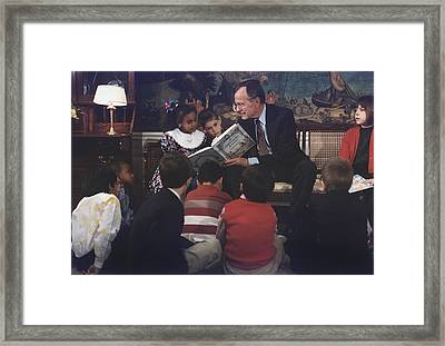 President George H. W. Bush Reads A Framed Print by Everett