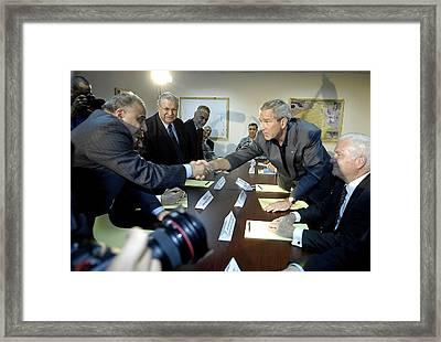 President George W. Bush Shakes Hands Framed Print by Everett