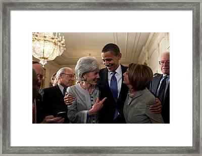 President Obama Embraces Health Framed Print by Everett