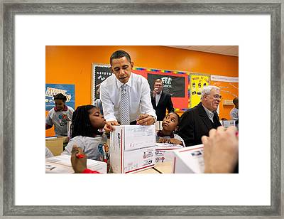 President Obama Flanked By Two Little Framed Print by Everett