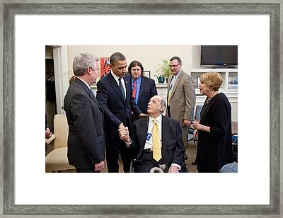 President Obama Greets James Brady Framed Print by Everett